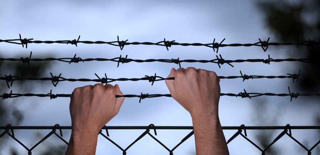 hands, barbed wire, trapped-6389396.jpg
